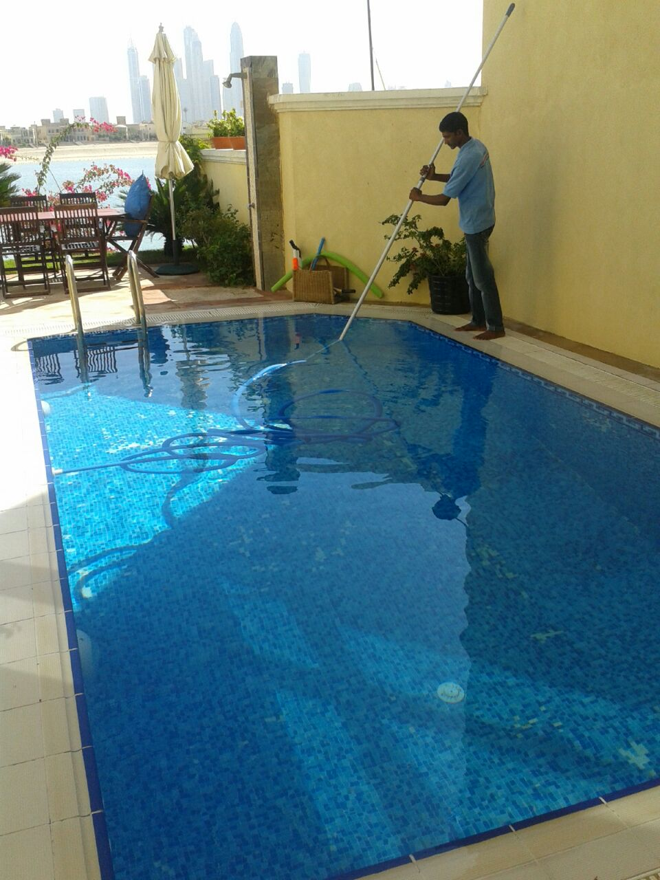 Pool cleaning staff